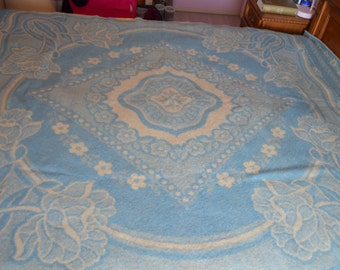 Very unusual vintage wool blanket with floral motifs in white and ice blue
