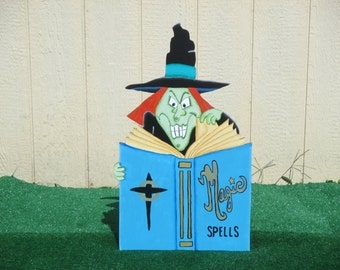 Halloween Witch and Her Magic Spells Book Yard Sign