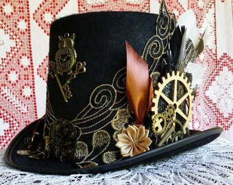 STEAMPUNK TOP HAT elegant, black with gold lace, feathers, cogs, keys, flowers, a clock and glasses.