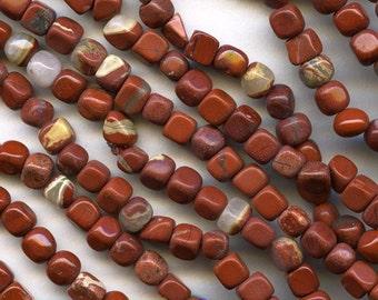 Vintage stock red jasper 4mm cubes, 18 inch strand. b4-jas230(e)