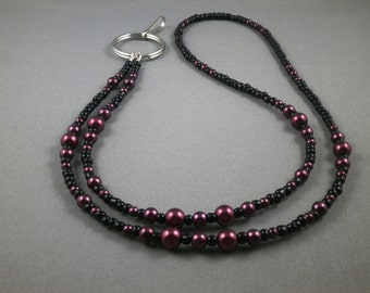 "burgundy and black beaded lanyard 28"" to 42"" plus attachment Your choice of attachment: ID , key or eyeglass holder"