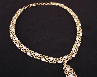 Vintage CROWN TRIFARI Brushed Gold Tone Swirl Rhinestone Necklace