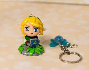 Link chibi polymer clay kawaii charm with a stand and a small fairy.