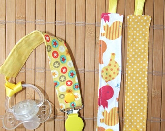 Removable pacifier, 3 in 1, in yellow tones