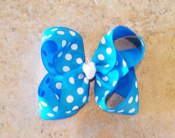 Blue and white polkadot bow