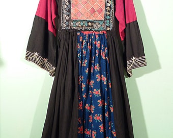 A beautiful Afghan dress with classic embroidery and blue floral fabric front.