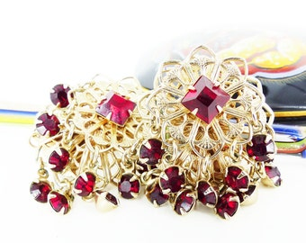 Glamorous gypsy cluster tassel ruby colored crystal earrings. Estate sale find. Gold filigree, clip on.