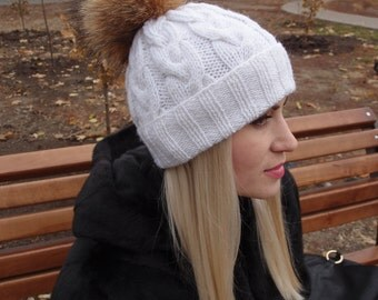 White knitted hat with a fur pompon, knitted hat braids, hat with a pompon of a raccoon, women's knitted hat, ladies hat handmade