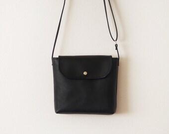 Mini black leather crossbody bag