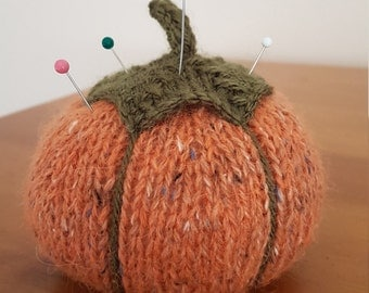 Knitted pumpkin pin cushion