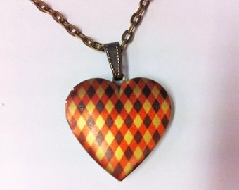 Ginger Lily Solid Perfume In Harlequin Heart Locket Essential oil, natural perfume. With red ribbon
