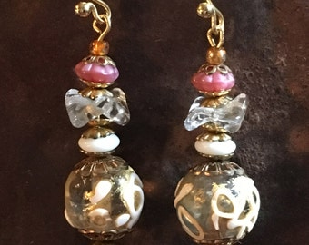 Earrings of hand made vintage Venetian and Czech glass beads with vintage gold tone findings and Bali Vermeil ear wires.