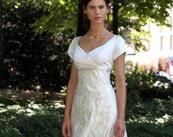 Romantic wedding gown in ivory, embroidered in light brown