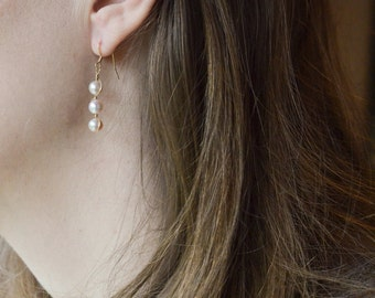 White Pearl Earrings Wrapped in Silver
