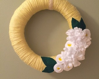 Yellow Yarn Wreath With White Flowers