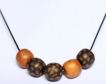 BALHANNAH | polymer clay 5 bead black & gold necklace