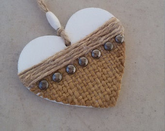 Wooden heart to hang with decorative jute and metal studs. Shabby chic country rock. Rustic metal decor, heart rocker.