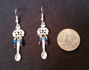 Spoon with purple and blue bead earrings.