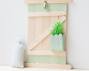 Door with green drawers and lamp