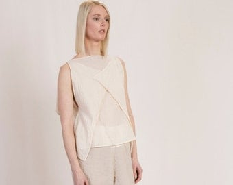 draped top from GOTS and IVN Fairforlife of certified organic cotton in natural or light blue