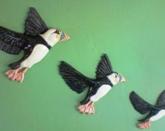 An Improbability of Puffins plaque. Ceramic wall hanging flying birds