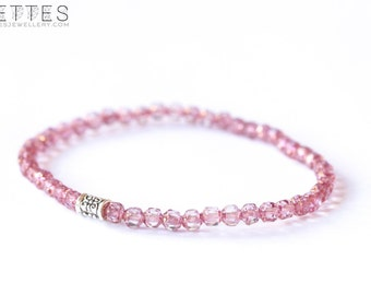 Pink bracelet with 4 mm glass bead and a tibetan focal bead