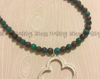 Silver Quatrefoil Pendant on Beaded Necklace