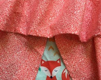 Ruffled crib skirt with matching crib sheet