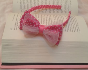 Minnie inspired headband with pink/white polkadots and soft white tulle. Fits toddlers and most kids.