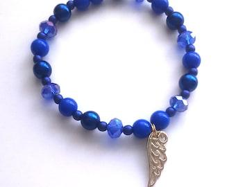 golden wing - beaded charm bracelet