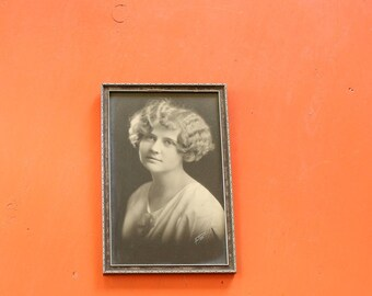 framed 1920s photograph of a woman with flapper hair bob and finger waves . silver gelatin print framed Gatsby era woman portrait