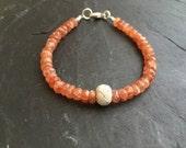 Mandarin garnet bracelet with a pure silver bead