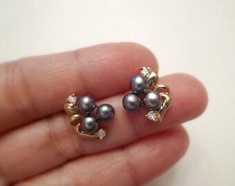 Amabelle Black . pearl stud earrings . GP 14K