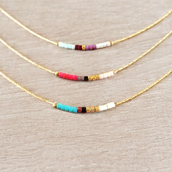 Minimalist gold delicate short necklace with tiny beads for Minimalist werden