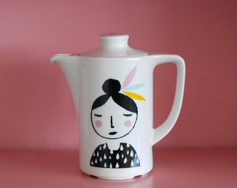 Small teapot girl with feathers in her hair