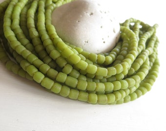 Small  green glass beads, opaque matte  lime seed  irregular spacer barrel tube  Modern Indo-pacific, 3 to 5mm  / 22 inches strand 6A14-23