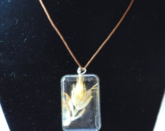 Handmade resin necklace with flower
