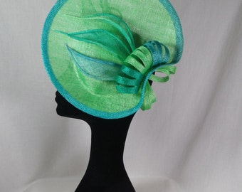 A bright apple green and turquoise hatinator