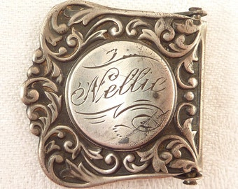 Antique Sterling Victorian Scrollwork Suspender Buckle Clip Engraved 'Nellie'