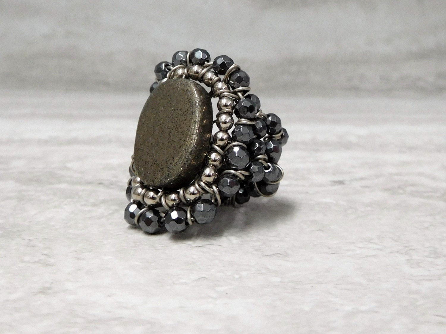 large ring with faceted grey hematite pewter pyrite