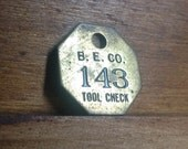 Vintage Brass B. E. Co. Tool Check Tag. Number 143. Industrial Craft Supplies.