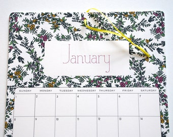 2017 Wall Calendar, size 8.5x11 inches featuring 12 different floral illustrations in green, fuchsia, orange, yellow, purple and lavender