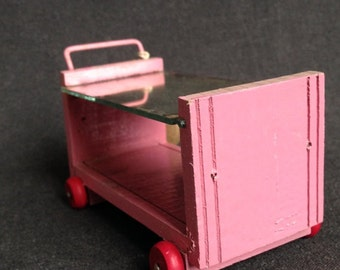 Antique pink service side table for the doll house. Miniature collectible retro toy.