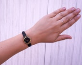 Vintage Gucci Gold and Black Women's Watch, Small Round Striped Edge, Gold with Black Leather Band, Quartz Movement Switzerland 510018
