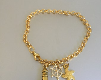 Gold Lighthouse, Ships Wheel and Starfish Bracelet