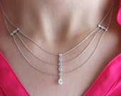 14K white gold pear shape, marquise and round diamonds necklace.