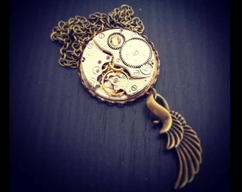Steampunk Inspired with a wing ~ Timeless Relic in Brass Setting