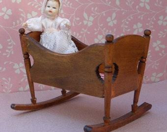 Vintage wooden dollhouse roccking cradle