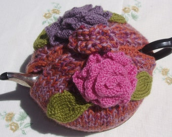 Floral Teapot cosy in Hand knitted pink & mauve wool for medium teapot 4 - 5 cups (250 ml).