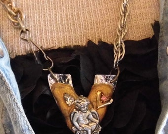Found object necklace with vintage, flea market edge.
